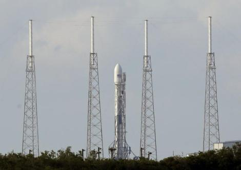 A SpaceX Falcon 9 rocket carrying a payload of Orbcomm communications satellites is seen at launch complex 40 after an attempted launch was scrubbed due to technical issues at the Cape Canaveral Air Force Station in Cape Canaveral, Fla.