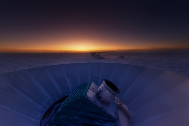 The BICEP2 telescope at twilight, which occurs only twice a year at the South Pole. The MAPO observatory (home of the Keck Array telescope) and the South Pole station can be seen in the background.