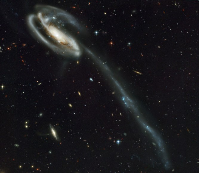 This picture of the galaxy UGC 10214 was taken by the Advanced Camera for Surveys (ACS), which was installed aboard the NASA/ESA Hubble Space Telescope in March during Servicing Mission 3B.