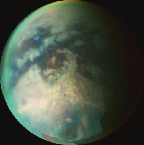 This image is a composite of several images taken during two separate Titan flybys in 2006. The large circular feature near the center of Titan's disk may be the remnant of a very old impact basin. The mountain ranges to the southeast of the circular feature, and the long dark, linear feature to the northwest of the old impact scar may have resulted from tectonic activity on Titan caused by the energy released when the impact occurred. Image credit: NASA/JPL/University of Arizona.