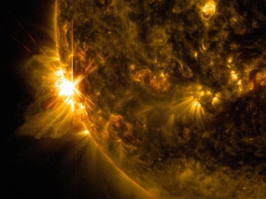 This image from NASA's Solar Dynamic Observatory captures the first of three giant flares erupting from the sun's surface on June 10, 2014. Credit: NASA/SDO/Goddard/Wiessinger