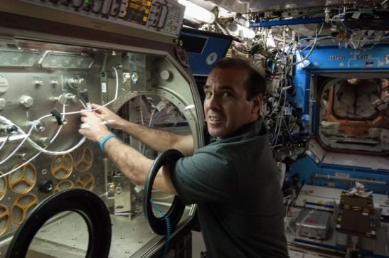 NASA astronaut Rick Mastracchio prepares to test the ultraviolet light decontamination hardware (Image: NASA)