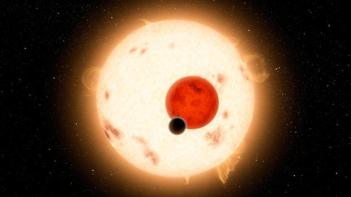 Artist conception of a rocky planet in a binary star-system, one of which is a red dwarf. (NASA/JPL-Caltech/R. Hurt via Getty Images)