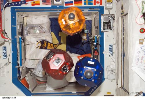 Three satellites fly in formation as part of the Synchronized Position Hold, Engage, Reorient, Experimental Satellites (SPHERES) investigation. This image was taken during Expedition 14 in the Destiny laboratory module. (Credit: NASA)
