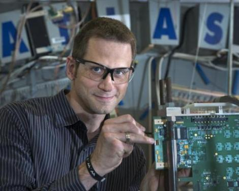 Brookhaven Lab/ATLAS physicist Marc-André Pleier adjusting detector components. (Credit: Brookhaven Lab/ATLAS)