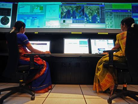Scientists from the Indian Space Research Organisation work in the Indian Regional Navigational Satellite System control room at the Indian Deep Space Network (Credit: AP)