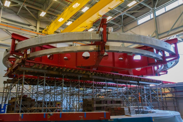 The 50-foot-wide Muon g-2 electromagnet at rest inside the Fermilab building that will house the experiment. The magnet was moved into the new building on Wednesday, July 30, 2014. The magnet will allow scientists to precisely probe the properties of subatomic particles called muons. (Credit: Fermilab.)