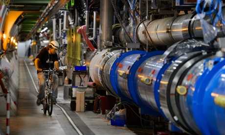 A worker rides on his bicycle in the CERN's Large Hadron Collider (LHC) tunnel during maintenance works. (Credit:  AFP  / FABRICE COFFRINIFABRICE COFFRINI/AFP/Getty Images)