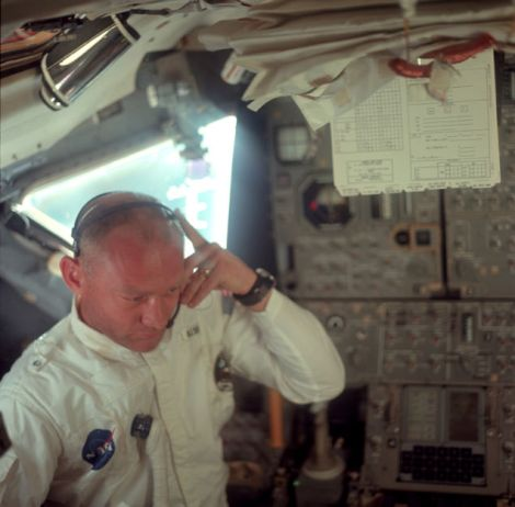 Buzz Aldrin listening to mission control transmission during translunar coast NASA/Project Apollo Archive