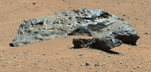"This photo by NASA's Curiosity Mars rover shows the huge iron meteorite ""Lebanon"" (7 feet wide) and its smaller companion ""Lebanon B."" The two meteorites were found by Curiosity on May 25, 2014. The circular insets are more detailed views by Curiosity's Chem-Cam instrument overlaid on an image by the rover's Remote Micro-Imager. (Credit: NASA/JPL-Caltech/LANL/CNES/IRAP/LPGNantes/CNRS/IAS/MSSS)"