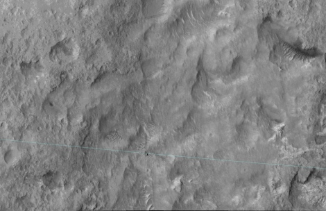 The blue line added to this June 27, 2014, image from the High Resolution Imaging Science Experiment (HiRISE) camera on NASA's Mars Reconnaissance Orbiter is the edge of the ellipse that was charted as safe terrain for the rover's August 2012 landing. Curiosity is visible right on the ellipse line in the lower center of the image. This 3-sigma landing ellipse is about 4 miles long and 12 miles wide (7 kilometers by 20 kilometers). Curiosity reached the edge of it for the first time with a drive of about 269 feet (82 meters) earlier that day. (Credit: NASA)