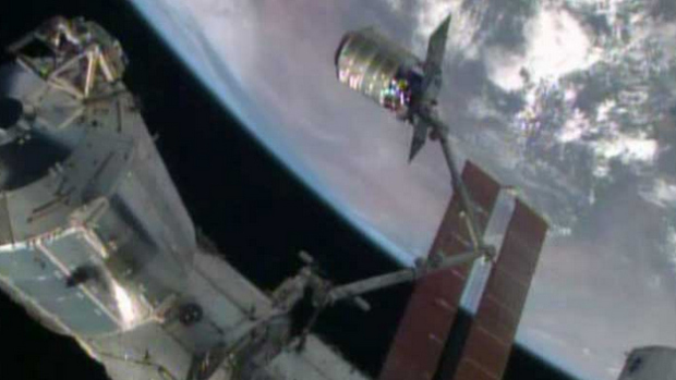 The International Space Station's robotic arm, Canadarm2, grapples the Orbital Sciences' Cygnus cargo craft. (Source: NASA TV)