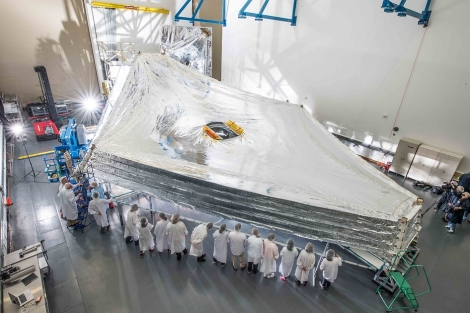 The James Webb Space Telescope (sometimes called JWST) is an orbiting infrared observatory that will complement and extend the discoveries of the Hubble Space Telescope, with longer wavelength coverage and greatly improved sensitivity.(Credit: NASA/Chris Gunn)