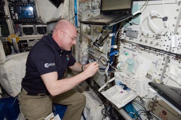 European Space Agency astronaut Andre Kuipers, Expedition 30 flight engineer, prepares vials in the Columbus laboratory of the International Space Station for venous blood sample draws during an immune system investigation. (Credit: NASA)