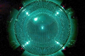 The Borexino neutrino detector uses a sphere filled with liquid scintillator that emits light when excited. This inner vessel is surrounded by layers of shielding and by about 2,000 photomultiplier tubes to detect the light flashes.(Credit: Borexino Collaboration)