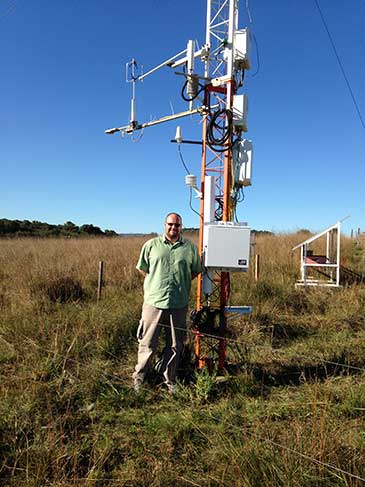 Dr Rosolem with the cosmic-ray soil moisture sensor installed at the the Federal University of Santa Maria SulFlux site in Brazil