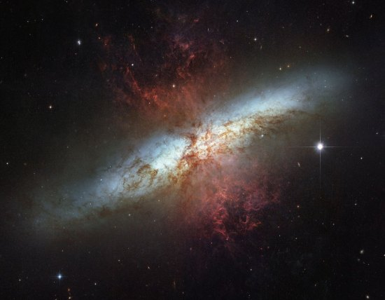 "To celebrate the NASA-ESA Hubble Space Telescopes 16 years of success, NASA and the European Space Agency are releasing this mosaic image of the starburst galaxy, Messier 82 (M82),  made in March 2006. It is the sharpest wide-angle view ever obtained of M82, a galaxy remarkable for its webs of shredded clouds and flame-like plumes of glowing hydrogen blasting out from its central regions. Located 12 million light-years away, it is also called the ""Cigar Galaxy"" because of the elongated elliptical shape produced by the tilt of its starry disk relative to our line of sight. (AP Photo/NASA-ESA)"
