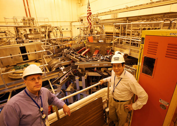 Jonathan Menard, a principal research physicist and program director for the National Spherical Torus Experiment (NSTX), and Masa Ono, a principal research physicist and project director of the NSTX, stand in front of the experiment during a tour of the facility. The device has been shut down since 2011 while it undergoes a $94 million upgrade that will make it the most powerful device of its kind in the world