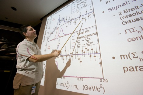 CDF physicist Petar Maksimovic, professor at Johns Hopkins University, presented the discovery to the particle physics community at Fermilab. He explained that the two types of Sigma-sub-b particles are produced in two different spin combinations, J=1/2 and J=3/2, representing a ground state and an excited state, as predicted by theory. (Credit: Fermilab)
