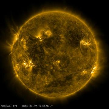 NASA's Solar Dynamics Observatory captured this image of what the sun looked like on April 23, 2013, at 1:30 p.m. EDT when the EUNIS mission launched. EUNIS focused on an active region of the sun, seen as bright loops in the upper right in this picture. (Credit: NASA/SDO)