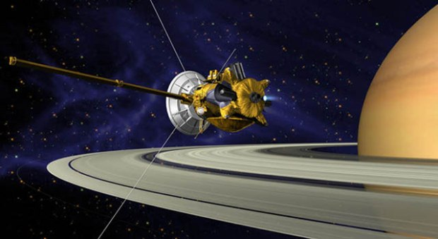 This is an artists concept of Cassini during the Saturn Orbit Insertion (SOI) maneuver, just after the main engine has begun firing. (Credit: NASA/JPL)