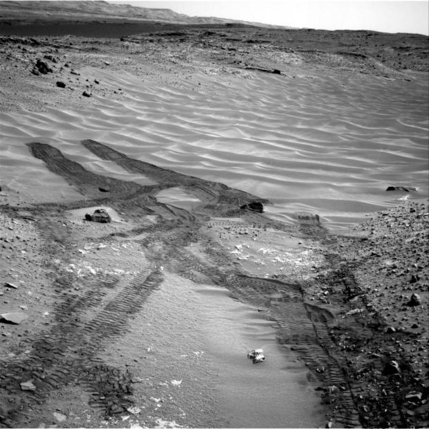 """This image, taken by NASA's Mars rover Curiosity in August 2014, looks across the northeastern end of sandy """"Hidden Valley"""" to the lower slopes of Mount Sharp on the horizon. (Credit: NASA/JPL-Caltech)"""