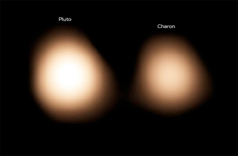 The cold surface of Pluto and its largest moon Charon as seen with ALMA on July 15, 2014. (Credit: /AUI/NSF)