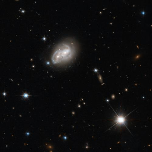 From objects as small as Newton's apple to those as large as a galaxy, no physical body is free from the stern bonds of gravity, as evidenced in this stunning picture captured by the Wide Field Camera 3 and Advanced Camera for Surveys onboard the NASA/ESA Hubble Space Telescope. (Credit: ESA/Hubble & NASA, Acknowledgement: Luca Limatola)