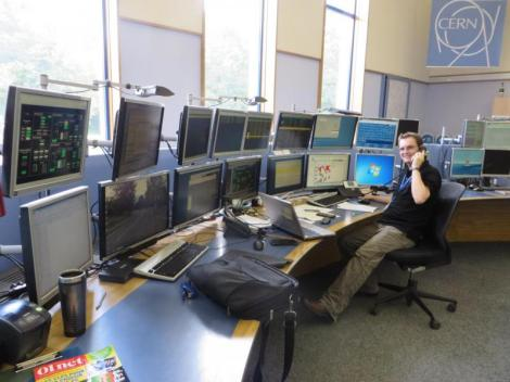 Chris Wetton of CERN's Technical Infrastructure Operation group keeps a keen eye on the monitors at the CERN Control Centre (Image: Stephanie Hills)