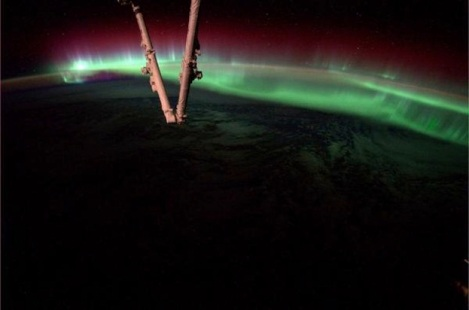 An aurora dances in the atmosphere on Aug. 20, 2014, as the International Space Station flew over North America. This image was captured by astronaut Reid Wiseman from his vantage point on the ISS. (Credit: NASA/Handout/QMI Agency)