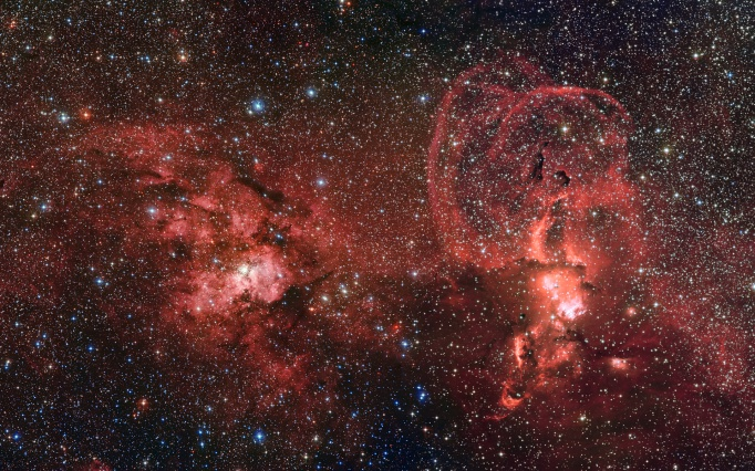 This mosaic of images from the Wide Field Imager on the MPG/ESO 2.2-metre telescope at ESO's La Silla Observatory in Chile shows two dramatic star formation regions in the southern Milky Way. (Credit: ESO/G. Beccari)