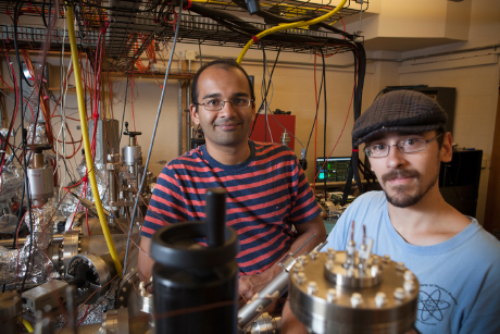Siddharth Karkare, left, and Laurent Boulet '14 in the Newman Hall photocathode research lab. (Credit: Lindsay France/University)