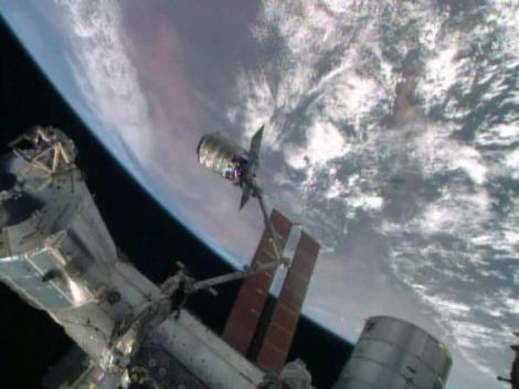 The International Space Station's robotic arm, Canadarm2, grapples the Orbital Sciences' Cygnus cargo craft, as seen in this still image taken from NASA TV July 16, 2014.  (Credit: Reuters/NASA TV/Handout via Reuters)