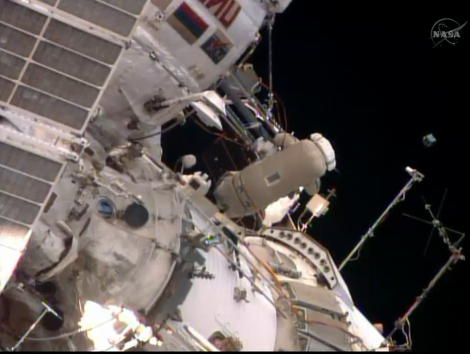 Cosmonaut Oleg Artemyev looks on after he released a small Peruvian satellite into space during a spacewalk outside the International Space Station on Aug. 18, 2014. (Credit: NASA TV)