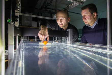 Dr Horst Punzmann (left) and Professor Michael Shats test their wave-generated tractor beam. (Credit: Stuart Hay)