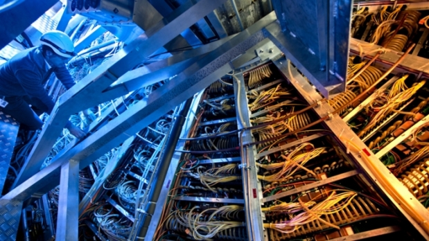 As time ticks down to the restart of the Large Hadron Collider, scientists are making sure their detectors run like clockwork.Photo by Antonio Saba, CERN