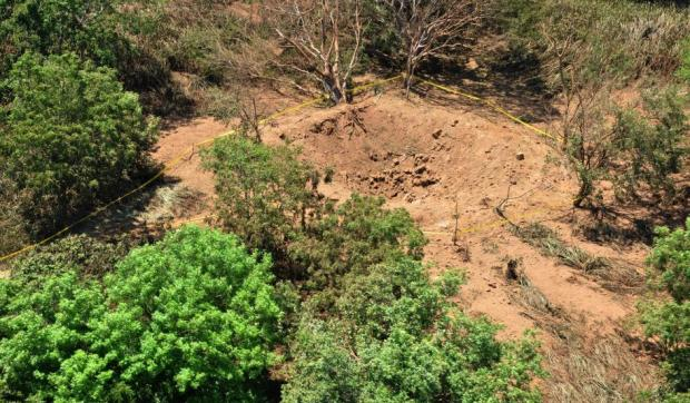 "In this Sunday Sept. 7, 2014, publicly distributed handout photo provided by the Nicaraguan Army shows an impact crater made by a small meteorite in a wooded area near Managua's international airport and an air force base. Nicaraguan government spokeswoman Rosario Murillo said Sunday that a loud boom heard overnight by residents of the capital was a ""relatively small"" meteorite that ""appears to have come off an asteroid that was passing close to Earth."" (Credit: Nicaraguan Army/AP)"