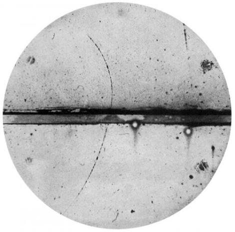 Photograph of a cloud chamber showing the first discovered positron. (Credit: Carl D. Anderson)