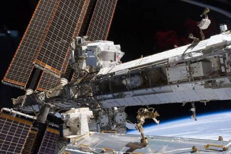 The starboard truss of the International Space Station while Space Shuttle Endeavour docked with the station. The newly installed Alpha Magnetic Spectrometer (AMS) is visible at center left. (Credit: NASA)