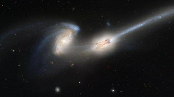 "Larger galaxies are unable to create new stars at a rapid enough pace so they start to ""eat"" stars in neighboring galaxies. (Photo By Nasa/Getty Images)"