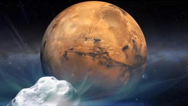 An artist's concept shows comet Siding Spring (C/2013 A1) heading toward Mars. (Credit: NASA)
