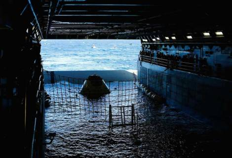 A test version of NASA's Orion capsule floats in the rear of the USS Anchorage during a recovery drill off the coast of California September 15, 2014. Orion is NASA's next exploration spacecraft, designed to carry astronauts to destinations in deep space, including an asteroid and Mars. Picture taken September 15, 2014.  (Credit: REUTERS/Mike Blake)