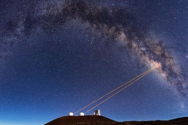 Telescopes at the Keck Observatory use adaptive optics, which enabled UCLA astronomers to discover that G2 is a pair of binary stars that merged together. (Credit:  Ethan Tweedie)