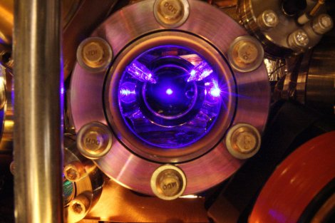 Strontium atoms floating in the center of this photo are the heart of the world's most precise clock. The clock is so exact that it can detect tiny shifts in the flow of time itself. (Credit: Ye group, Brad Baxley/JILA)