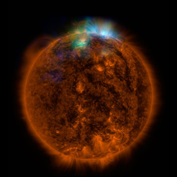 X-rays stream off the sun in this image showing observations from by NASA's Nuclear Spectroscopic Telescope Array, or NuSTAR, overlaid on a picture taken by NASA's Solar Dynamics Observatory (SDO).This image shows that some of the hotter emission tracked by NuSTAR is coming from different locations in the active regions and the coronal loops than the cooler emission shown in the SDO image.  (Credit: NASA/JPL-Caltech )