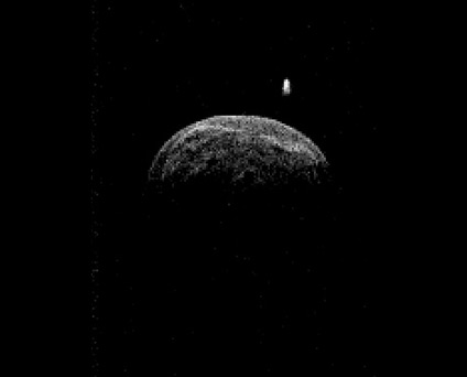 Radar image of asteroid 2004 BL86 made by the Green Bank Telescope from radar transmitted from NASA's Goldstone Deep Space Network antenna. It reveals clear surface features and a companion moon-like body. (Credit: NASA/JPL-Caltech; NRAO/AUI/NSF)
