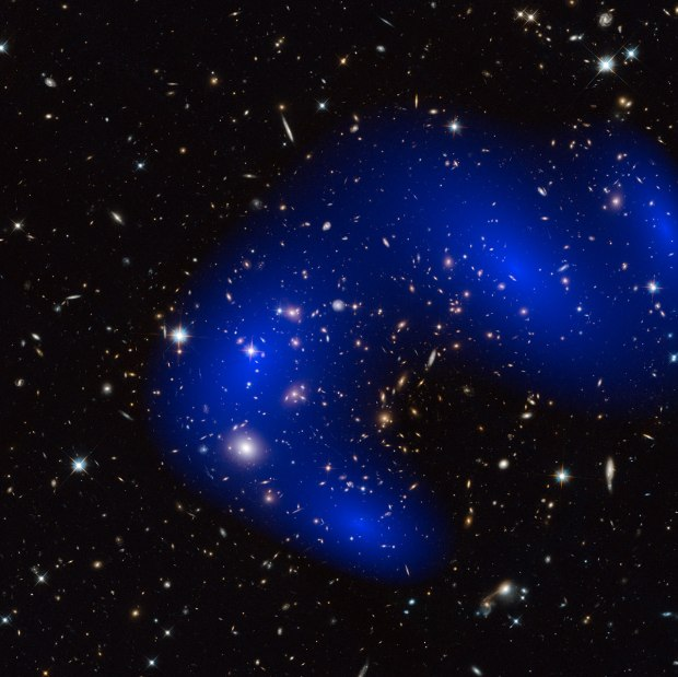 This is a NASA/ESA Hubble Space Telescope image of the galaxy cluster Abell 370. Shown in blue on the image is a map of the dark matter found within the cluster. (Credit NASA, ESA)
